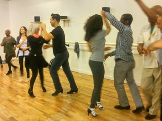Students taking a salsa class